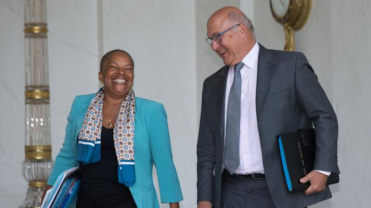 French Justice minister Taubira and Finance minister Sapin leave the Elysee Palace in Paris, following the weekly cabinet meeting