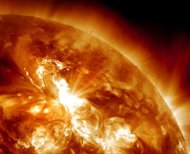 This January 23, 2012 image provided by NASA, captured by the Solar Dynamics Observatory, shows a solar flare erupting on the Sun's northeastern hemisphere at 03:49 UT. Solar radiation from a massive sun storm -- the largest in nearly a decade -- collided with the Earth's atmosphere on Tuesday, prompting an airline to reroute flights and skywatchers to seek out spectacular light displays. (AFP Photo/)
