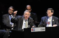<p>In a picture released by the Chilean Presidency, Cuban President Raul Castro (L) delivers a speech as his Foreign Minister Bruno Rodriguez looks on at the Latin American and Caribbean States (CELAC) Summit in Santiago, on January 28, 2013.</p>