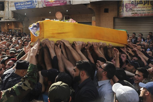 Supporters of Hezbollah and relatives of Hasan Faisal Sheker , an 18-year-old Hezbollah member, carry the coffin during his funeral in Nabi Sheet near Baalbeck
