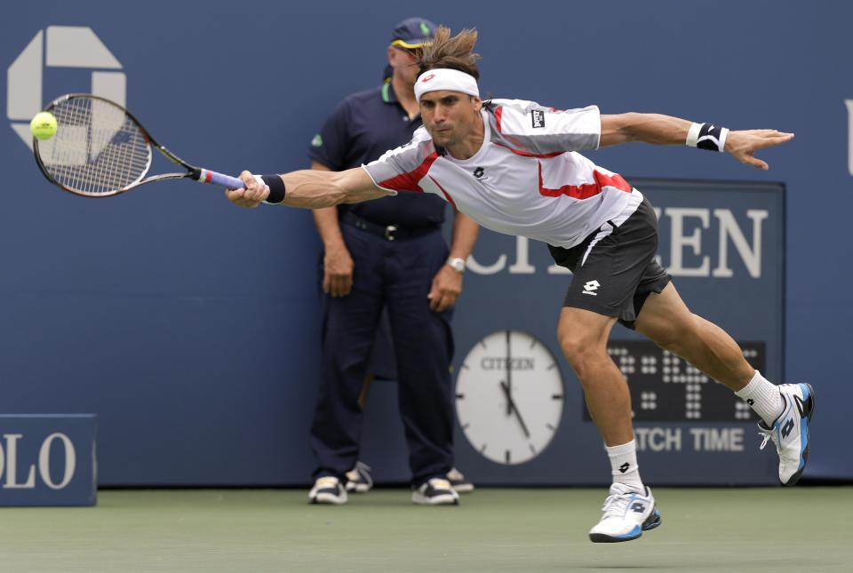 Spain's David Ferrer returns a shot against Janko Tipsarevic of Serbia in the quarterfinals during the 2012 US Open tennis tournament,  Thursday, Sept. 6, 2012, in New York. (AP Photo/Peter Morgan)