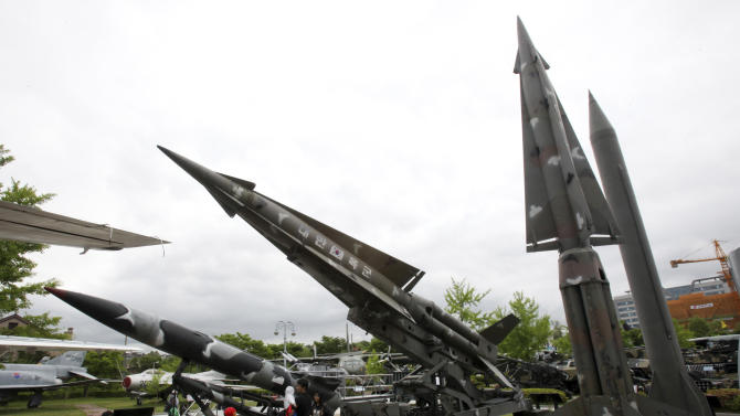 A mock Scud-B missile of North Korea, right, and other South Korean missiles are displayed at Korea War Memorial Museum in Seoul, South Korea, Sunday, May 19, 2013. North Korea fired a projectile into waters off its eastern coast Sunday, a day after launching three short-range missiles in the same area, officials said. (AP Photo/Ahn Young-joon)