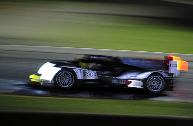 Tom Kristensen, of Denmark, goes through a corner in an Audi during night practice for the American Le Mans Series' Petit Le Mans auto race at Road Atlanta, Thursday, Sept. 29, 2011, in Braselton, Ga.