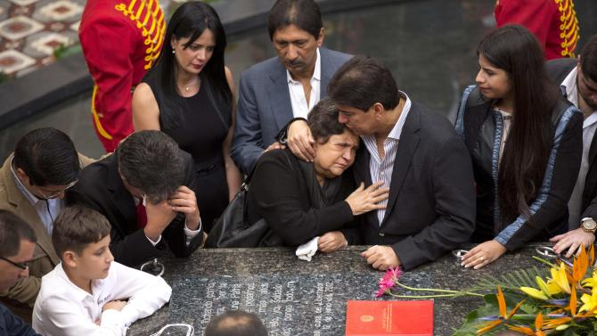 Elena de Chavez stands at the tomb of her son, Venezuela's late President Hugo Chavez, as she, family members and government officials gather on second anniversary of Chavez's death inside the 4F military museum in Caracas, Venezuela, Thursday, March 5, 2015. Chavez died of cancer at age 58 on March 5, 2013. (AP Photo/Ariana Cubillos)