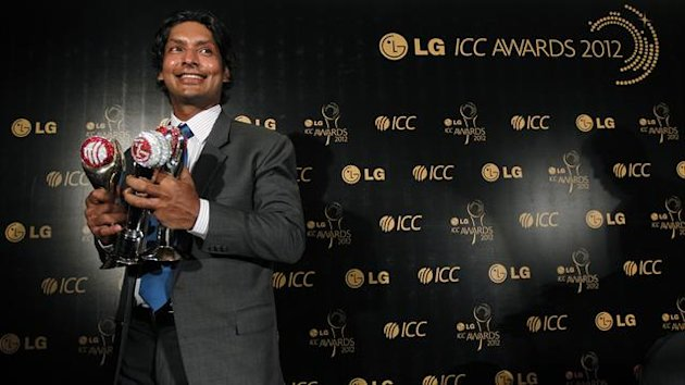 Sri Lanka's Kumar Sangakkara, who won the International Cricket Council (ICC)'s Test Cricketer of the Year Award, People's Choice Award and Sir Garfield Sobers Trophy, poses with his awards during the ICC Awards in Colombo (Reuters)