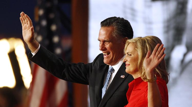 Republican presidential nominee Mitt Romney and his wife Ann wave to delegates following her speech at the Republican National Convention in Tampa, Fla., on Tuesday, Aug. 28, 2012. (AP Photo/Lynne Sladky)
