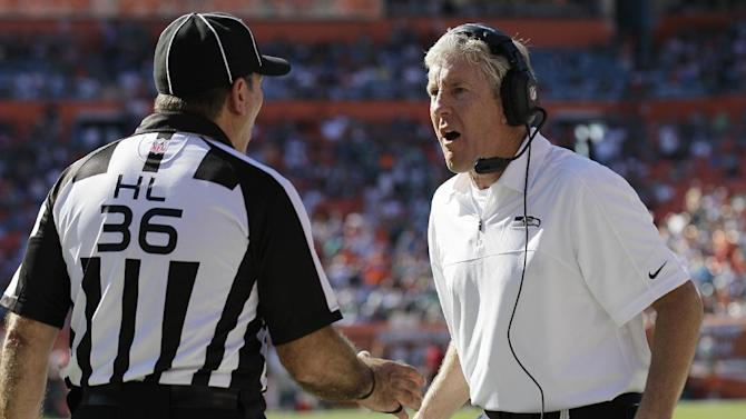 Seattle Seahawks head coach Pete Carroll argues the Miami Dolphins touchdown with head linesman Tony Veteri (36) during the first half of an NFL football game Sunday, Nov. 25, 2012 in Miami . (AP Photo/Gerry Broome)
