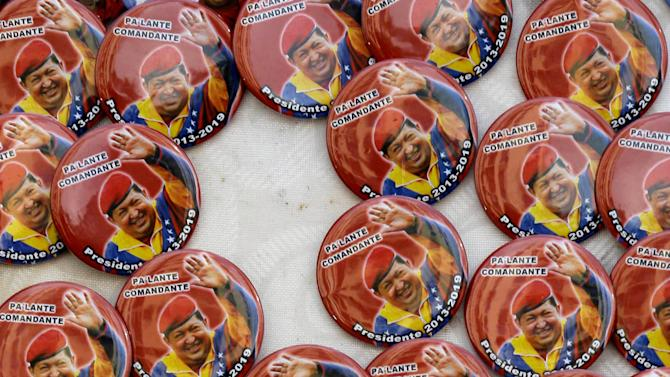 Buttons of Venezuela's President Hugo Chavez sit for sale on the sidelines of a pro-Chavez rally in Caracas, Venezuela, Wednesday, Jan. 23, 2013. The cult of personality that Chavez long nurtured has been flourishing like never before as he confronts an increasingly difficult struggle against the mysterious cancer that afflicts him. (AP Photo/Fernando Llano)