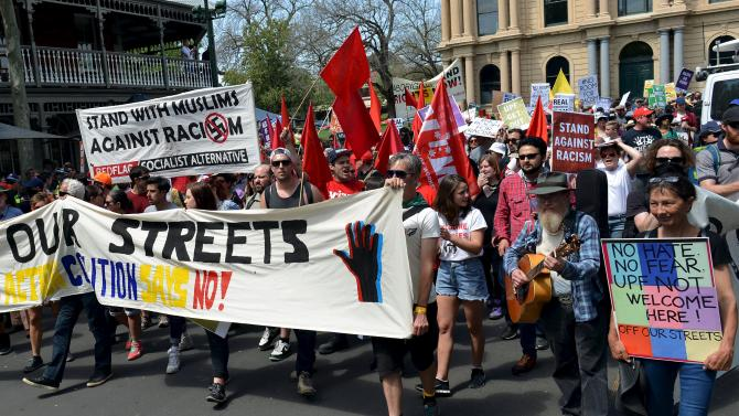 Members of the left-wing coalition hold banners and placards as they march down a main street in the town of Bendigo, located in the state of Victoria, Australia