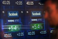 <p>Screens display the start of trading in Facebook shares at the NASDAQ stock exchange in Times Square in New York in May 2012. After a dire stock market debut, Facebook has clawed back a large chunk of its losses as investors look past the flubbed initial public offering and gradually warm to the leading social network.</p>