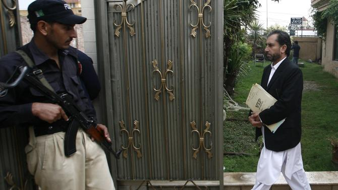 Samiullah Afridi, a Pakistani doctor who tried to help U.S. officials find Osama bin laden, leaves the court building in Peshawar