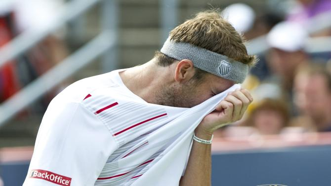 Mardy Fish, from the United States, wipes his face during his match against Novak Djokovic, from Serbia, during the men's final at the Rogers Cup tennis tournament on Sunday, Aug. 14, 2011, in Montreal. Novak Djokovic won 6-2, 3-6, 6-4. (AP Photo/The Canadian Press, Paul Chiasson)