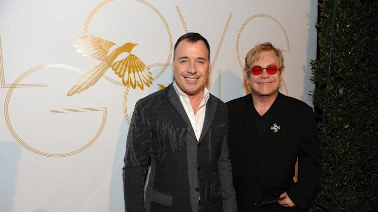 "IMAGE DISTRIBUTED FOR LOVEGOLD - David Furnish and Elton John attend LoveGold/EJAF Celebrate ""How to Survive a Plague"" at Chateau Marmont on February 22, 2013 in Los Angeles. (Photo by Jordan Strauss/Invision for LoveGold/AP Images)"