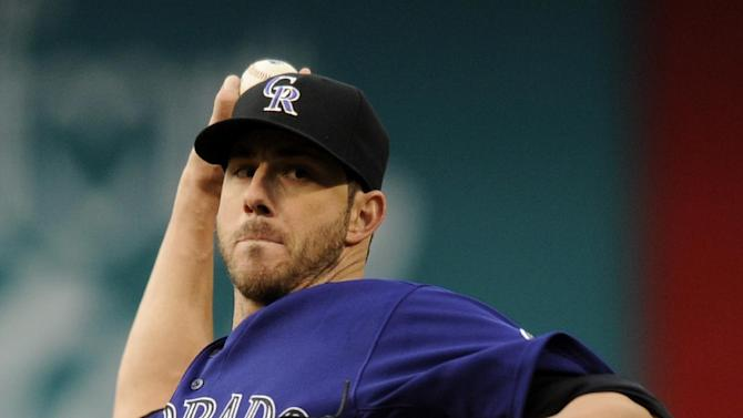 Colorado Rockies starting pitcher Jon Garland throws against the Arizona Diamondbacks during the first inning of a baseball game on Monday, May 20, 2013, in Denver. (AP Photo/Jack Dempsey)