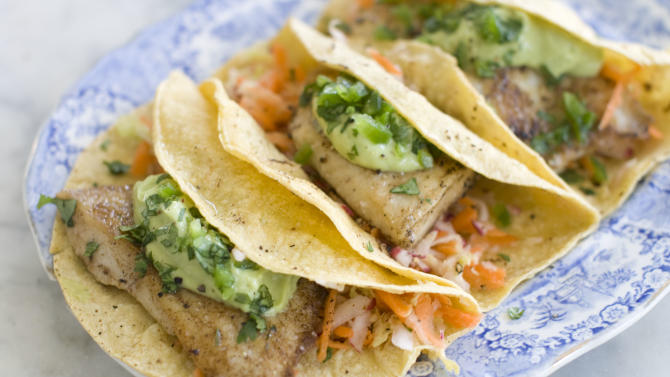 This June 3, 2013 photo taken in Concord, N.H. shows a recipe for healthy fish tacos with avocado. (AP Photo/Matthew Mead)
