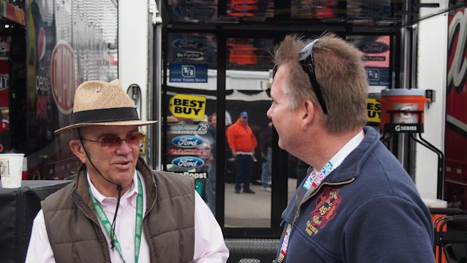 NASCAR Sprint Car Owner Jack Roush (L) signs an autograph and talks with fan Jeff Zook at Martinsville Speedway on Sunday, October 28, 2012 in Martinsville, Va.  (AP Photo/Steve Sheppard)