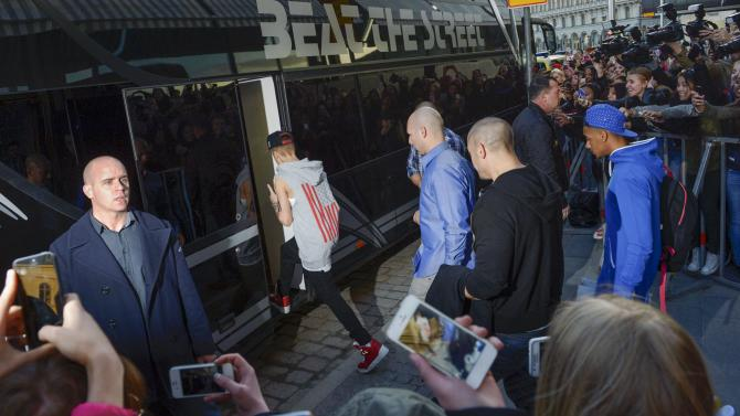FILE - This Tuesday April 23, 2013, photo from files shows singer Justin Bieber boarding his tour bus outside Grand Hotel where Bieber was staying during his concerts in Stockholm, Sweden. Swedish police said on Thursday they found drugs on Bieber's tour bus in Stockholm, but had no suspects and were unlikely to pursue the case further. (AP Photo/Scanpix Sweden, Leo Sellen, File)   SWEDEN OUT