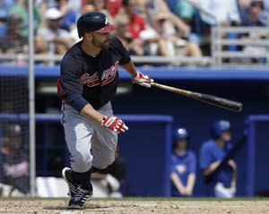 Atlanta Braves' Reed Johnson hits a fifth-inning two-run single in a spring training baseball game against the Toronto Blue Jays in Dunedin, Fla., Saturday, March 23, 2013. (AP Photo/Kathy Willens)