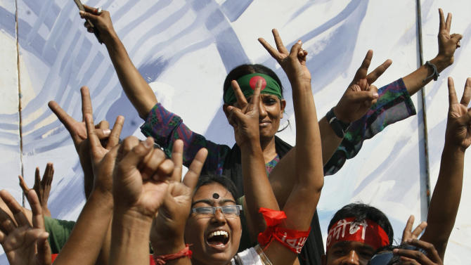 Bangladeshi youth gesture while celebrating the death sentence awarded to Jamaat-e-Islami leader Delwar Hossain Sayedee in Dhaka, Bangladesh, Thursday, Feb. 28, 2013. A special war crimes tribunal in Bangladesh on Thursday sentenced Sayedee, the leader of an Islamic political party to death for crimes stemming from the nation's 1971 fight for independence, a politically charged decision that sparked violent protests. (AP Photo/Pavel Rahman)