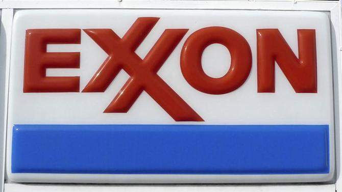 Exxon corporate logo is pictured at a gas station in Arlington