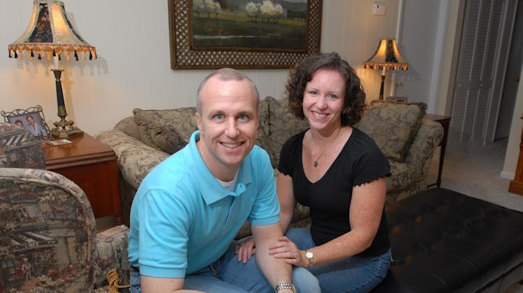 "FILE - In this Thursday, May 11, 2006 file photo, Alan Chambers, left, president of Exodus International, sits with his wife, Leslie, in their home in Winter Park, Fla. The president of the country's best-known Christian ministry dedicated to helping people repress same-sex attraction through prayer is trying to distance the group from the idea that gay people's sexual orientation can be permanently changed or ""cured."" Chambers said Tuesday, June 26, 2012 that their upcoming national conference would highlight his efforts to dissociate the group from the controversial practice usually called ex-gay, reparative or conversion therapy. (AP Photo/Phelan M. Ebenhack)"