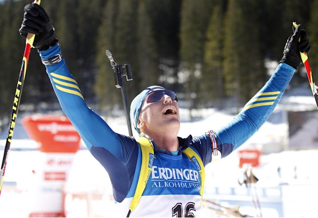Sweden's Bjoern Ferry celebrates his victory in the men's 15km mass start at the biathlon World Cup competition in Pokljuka, Slovenia, Sunday, March 9, 2014