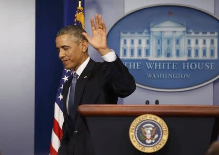 U.S. President Barack Obama departs at the conclusion of his end of the year press conference in the briefing room of the White House in Washington