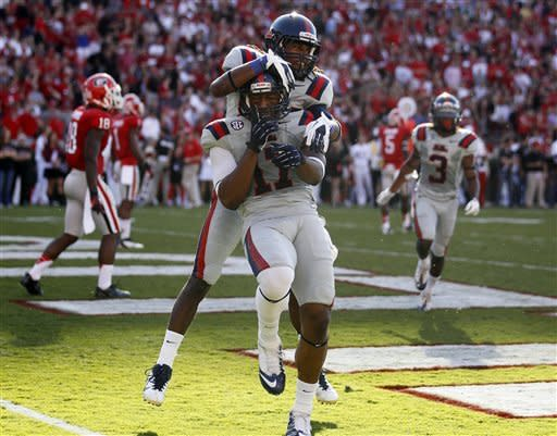 Murray's 4 TDs lead Georgia past Ole Miss 37-10