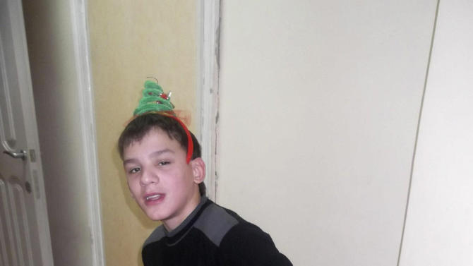 In this undated photo from a Facebook page of Maxim Kargopoltsev, on his approval, shows Maxim Kargapoltsev posing for a photo in an undisclosed location. A Russian teenage orphan who uses an American family's name on Facebook has become the unlikely poster boy of a Kremlin campaign to stop U.S. adoptions in Russia and help Russian children find new homes in their own country. After 14-year-old Maxim Kargopoltsev was reported to have written a letter to President Vladimir Putin asking for permission to be adopted by an American couple, he was shown on state television Thursday saying he had never written such a letter and wanted to stay in Russia. (AP Photo/HO, Maxim Kargopoltsev)