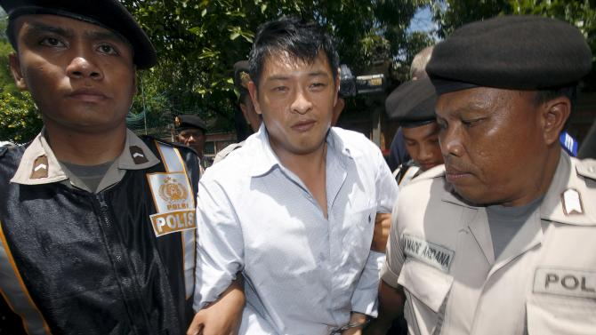 File photo of Australian Chan arriving at Denpasar District Court in Bali