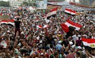 Supporters of Muslim Brotherhood presidential candidate Mohamed Morsi wave Egyptian flags and banners as they demonstrate in Cairo's landmark Tahrir Square. Tensions have soared in Egypt a day before the result of a divisive presidential election and as the Muslim Brotherhood sparred with the ruling generals over what it sees as a military power grab