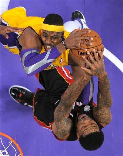 LeBron's Heat hold off Kobe's Lakers 99-90