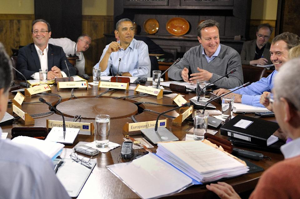 World leaders attend the first working session of the G-8 Summit at Camp David, Md,, Saturday, May 19, 2012.  From left are French President Francois Hollande, U.S. President Barack Obama, British Prime Minister David Cameron and Russian Prime Minister Dmitri Medvedev.  (AP Photo/Philippe Wojazer, Pool)