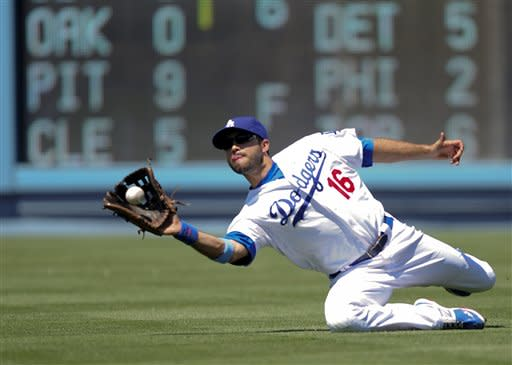 Los Angeles Dodgers right fielder Andre Ethier catches a hit from Chicago White Sox's Alex Rios for the third out in the sixth inning of a baseball game on Sunday, June 17, 2012, in Los Angeles. (AP Photo/Gus Ruelas)