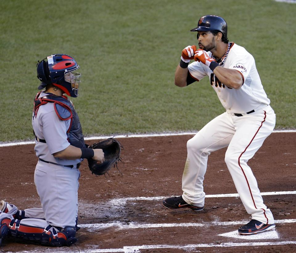 San Francisco Giants' Angel Pagan celebrates in front of St. Louis Cardinals catcher Yadier Molina after Pagan hit a home run during the first inning of Game 2 of baseball's National League championship series Monday, Oct. 15, 2012, in San Francisco. (AP Photo/Eric Risberg)