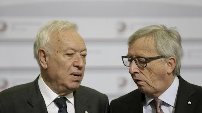 European Commission President Juncker listens to Spain's Minister of Foreign Affairs Garcia-Margallo before the Eastern Partnership Summit session in Riga
