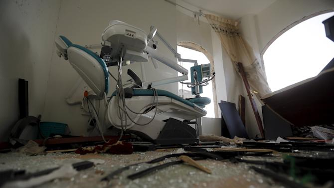 A dental clinic damaged in an air strike is seen in Sanaa