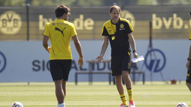 Borussia Dortmund's new coach Tuchel speaks to Mats Hummels during the first training session for the new soccer season in Dortmund