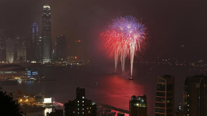 Fireworks explode over the Victoria Harbour to celebrate the Chinese New Year in Hong Kong Monday, Feb. 11, 2013.  (AP Photo/Vincent Yu)
