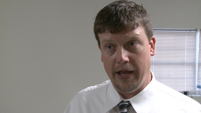 "In a this image made from video, Nelson City Council Member Duane Cronic discusses mandatory gun ownership after the city council voted to adopt it for all heads-of-household, Monday, April 1, 2013. Council members in Nelson, a city of about 1,300 residents that's located 50 miles north of Atlanta, voted unanimously to approve the Family Protection Ordinance. The measure requires every head of household to own a gun and ammunition to ""provide for the emergency management of the city"" and to ""provide for and protect the safety, security and general welfare of the city and its inhabitants."" (AP Photo/Johnny Clark)"