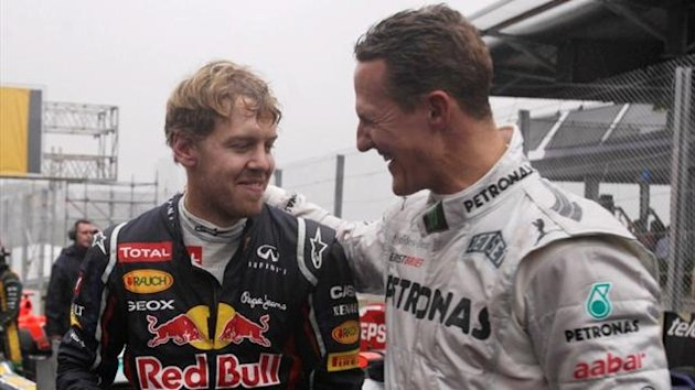 Red Bull's Sebastian Vettel and Mercedes' Michael Schumacher after the Brazilian Grand Prix (Reuters)