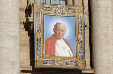 Tapestry featuring Pope John Paul II is seen in St. Peter's square at the Vatican