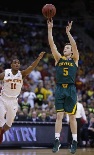 Baylor guard Brady Heslip (5) shoots a 3-point basket as Iowa State guard Monte Morris (11) defends during the first half of an NCAA college basketball game in the final of the Big 12 Conference men's tournament in Kansas City, Mo., Saturday, March 15, 2014. (AP Photo/Orlin Wagner)