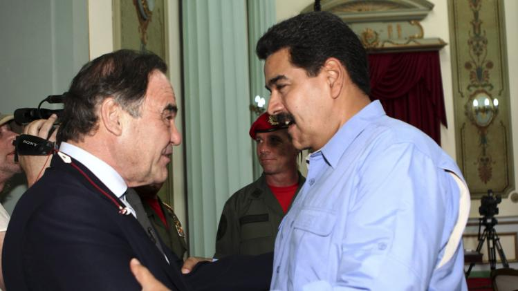 Venezuela's President Nicolas Maduro welcomes U.S. film director Oliver Stone during their meeting at Miraflores Palace in Caracas