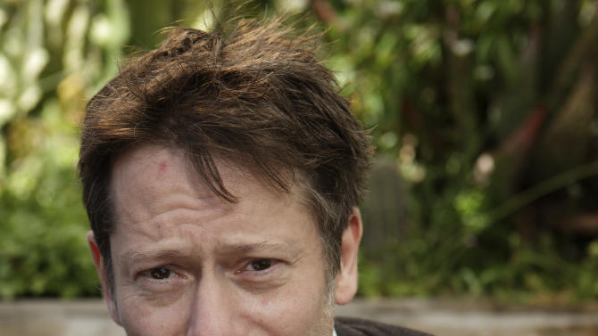 """In this photo taken Sunday, May 19, 2013, actor Mathieu Amalric poses for photographs following an interview with The Associated Press at the 66th international film festival, in Cannes, southern France. Amalric depicts a maverick academic counseling Benicio Del Toro's Native American war vet in """"Jimmy P.: Psychotherapy of a Plains Indian,"""" director Arnaud Desplechin's Cannes Film Festival contender. (AP Photo/David Azia)"""