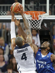 United States' Tyson Chandler shoots against France's Ronny Turiaf during the first half of a preliminary men's basketball game at the 2012 Summer Olympics, Sunday, July 29, 2012, in London. The U.S. men beat France 98-71. (AP Photo/Eric Gay)