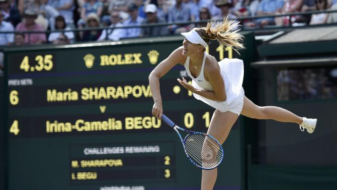 Maria Sharapova of Russia serves during her match against Irina-Camelia Begu of Romania at the Wimbledon Tennis Championships in London