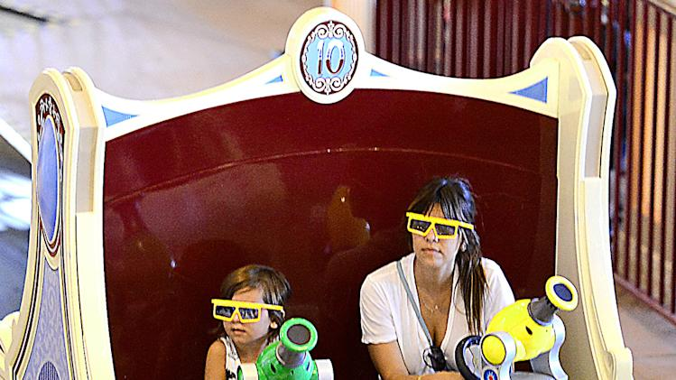EXCLUSIVE: Kourtney Kardashian enjoys the rides at Disneyland with son Mason in Anaheim, CA