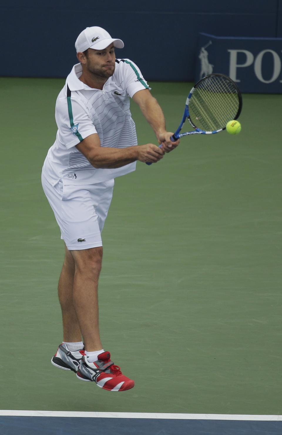Andy Roddick of the United States returns to David Ferrer of Spain during the U.S. Open tennis tournament in New York, Wednesday, Sept. 7, 2011. (AP Photo/Charlie Riedel)