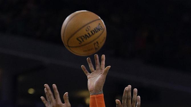 New York Knicks' Carmelo Anthony shoots over Golden State Warriors' Harrison Barnes during the first half of an NBA basketball game Monday, March 11, 2013, in Oakland, Calif. (AP Photo/Ben Margot)